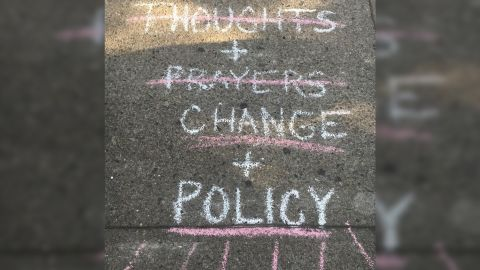 Chalk messages adorn the streets of the Oregon District where the deadly shooting happened Sunday morning.