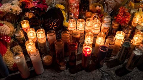 A memorial for victims of the El Paso shooting nearby a lot across from a Walmart in El Paso, Texas, Monday, Aug. 5, 2019.