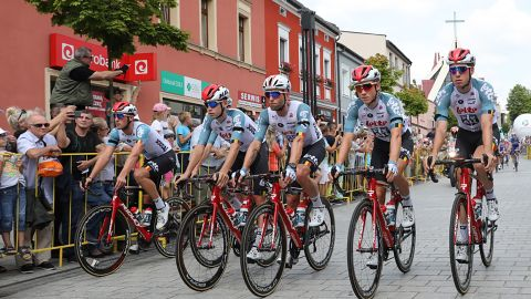 Lotto-Soudal team's cyclists wear black ribbons at the start of the shortened and neutralised Stage Four.