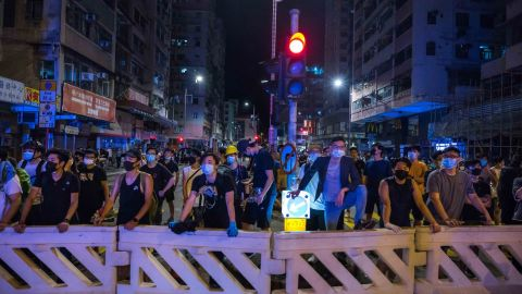 """HONG KONG, CHINA - AUGUST 6: Protestors stand off against riot police after a student's arrest at Sham Shui Po district on August 06, 2019 in Hong Kong, China. Pro-democracy protesters have continued rallies against a controversial extradition bill since June 9, when the city was plunged into crisis after waves of demonstrations and several violent clashes. While Hong Kong's Chief Executive Carrie Lam apologized for introducing the bill and declared it """"dead,"""" protests have continued to draw large crowds with demands for Lam's resignation and complete withdrawal of the bill. (Photo by Billy H.C. Kwok/Getty Images)"""