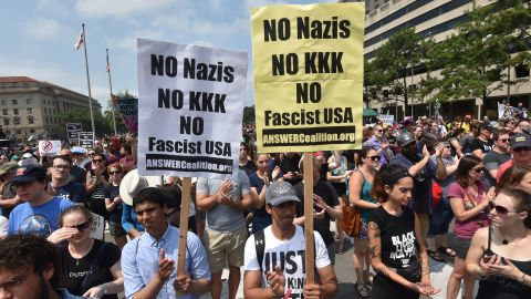 Demonstrators opposed to a far-right rally being held near the White House gather August 12, 2018 in Washington, DC, one year after deadly violence at a similar protest in Charlottesville, Virginia. - Last year's protests in Charlottesville, Virginia, that left one person dead and dozens injured, saw hundreds of neo-Nazi sympathizers, accompanied by rifle-carrying men, yelling white nationalist slogans and wielding flaming torches in scenes eerily reminiscent of racist rallies held in America's South before the Civil Rights movement. (Photo by Nicholas Kamm / AFP)        (Photo credit should read NICHOLAS KAMM/AFP/Getty Images)