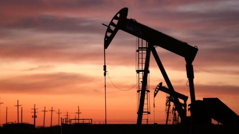 An oil pumpjack works at dawn in the Permian Basin oil field on January 20, 2016 in the oil town of Andrews, Texas.