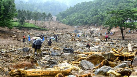 Volunteers, local residents and members of National Disaster Response Force search for survivors in the debris left by a landslide at Puthumala at Meppadi in the Wayanad district.