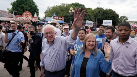 US Sen. Bernie Sanders and his wife, Jane, walk through the fairgrounds on Saturday. Most of the Democratic field visited the fair over the weekend.