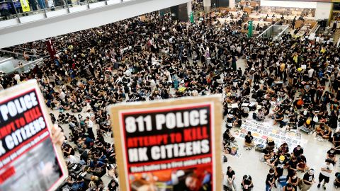 Pro-democracy protesters gather against the police brutality and the controversial extradition bill at Hong Kong's international airport on August 12, 2019. - Hong Kong airport authorities cancelled all remaining departing and arriving flights at the major travel hub on August 12, after thousands of protesters entered the arrivals hall to stage a demonstration. (Photo by Manan VATSYAYANA / AFP)        (Photo credit should read MANAN VATSYAYANA/AFP/Getty Images)