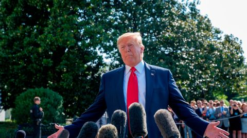 WASHINGTON, DC - AUGUST 09: US President Donald Trump speaks to members of the press before departing from the White House on the south lawn before he boards Marine One on August 09, 2019 in Washington, DC. Donald Trump spoke to reporters about gun background checks and the escalation of the US-China trade war. (Photo by Tasos Katopodis/Getty Images)