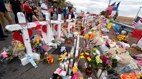 People leave flowers at a makeshift memorial for shooting victims at the Cielo Vista Mall Walmart, in El Paso, Texas, on August 6, 2019. - The August 3 shooting left 22 people dead.