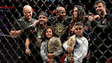 Cormier celebrates with his family and team after his win over Derrick Lewis.
