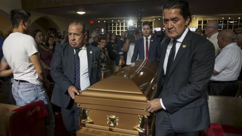Pallbearers carry Reckard's casket into a public memorial. Hundreds of people packed into the La Paz Faith Memorial and Spiritual Center in El Paso to attend the service.