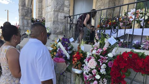 People deliver flowers for Reckard's funeral and memorial services.