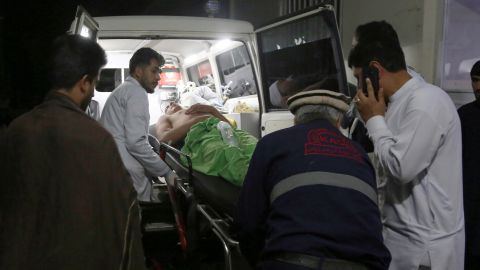 A wounded man is carried to a hospital after an explosion at wedding hall in Kabul, Afghanistan, Sunday, Aug.18, 2019. An explosion ripped through a wedding hall on a busy Saturday night in Afghanistan's capital and dozens of people were killed or wounded, a government official said. Hundreds of people were believed to be inside. (AP Photo/Nishanuddin Khan)