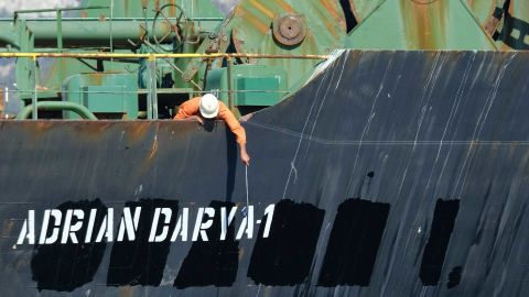 A crew member checks the new name of Iranian oil tanker Adrian Darya, formerly known as Grace 1.