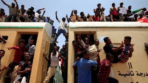 Sudanese civilians atop a train join in celebrations over the signing of a deal that paves the way for a transitional government in Khartoum, Sudan, on Saturday, August 17.