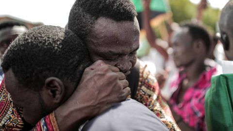 Sudanese men embrace outside the Friendship Hall in Khartoum where generals and protest leaders signed a historic transitional constitution, paving the way for civilian rule in Sudan.