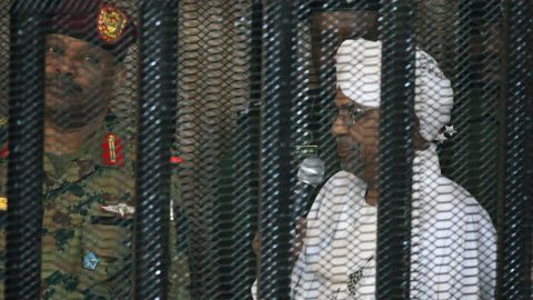 Sudan's deposed military ruler Omar al-Bashir stands in a defendant's cage during the opening of his corruption trial in Khartoum on August 19, 2019. - Bashir has admitted to receiving $90 million in cash from Saudi monarchs, an investigator told a Khartoum court today. (Photo by Ebrahim HAMID / AFP)        (Photo credit should read EBRAHIM HAMID/AFP/Getty Images)