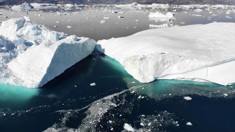 Two icebergs broken off from Helheim glacier collide in Sermilik Fjord in Eastern Greenland.