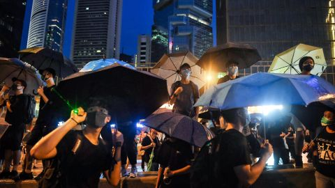 Protesters stand on Harcourt Road overlooking the Legislative Council during a rally in Hong Kong on August 18, 2019, in the latest opposition to a planned extradition law that has since morphed into a wider call for democratic rights in the semi-autonomous city. - Hong Kong democracy activists gathered August 18 for a major rally to show the city's leaders their protest movement still attracts wide public support despite mounting violence and increasingly stark warnings from Beijing. (Photo by Lillian SUWANRUMPHA / AFP)        (Photo credit should read LILLIAN SUWANRUMPHA/AFP/Getty Images)