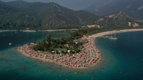 <strong>Ölüdeniz, Turkey:</strong> It's hard to fault the natural delights of Ölüdeniz: White sands, blue lagoon, the lushly covered Babadağ mountain. The trouble is, a lot of other people have discovered it too. <br />