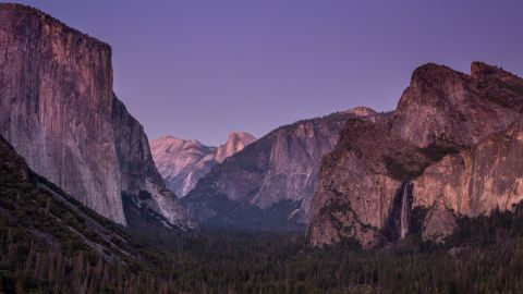 <strong>Yosemite National Park, California</strong>: A little after sunset, Yosemite Valley is bathed in pink light on an August evening.