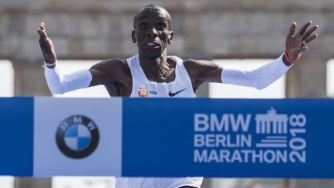 Kipchoge crosses the finish line to win the Berlin Marathon, setting a new world record.
