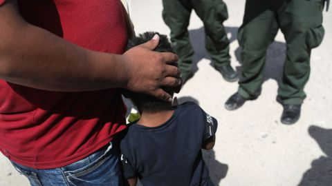 U.S. Border Patrol agents take a father and son from Honduras into custody near the U.S.-Mexico border on June 12, 2018 near Mission, Texas. The asylum seekers were then sent to a U.S. Customs and Border Protection (CBP) processing center for possible separation. U.S. border authorities are executing the Trump administration's zero tolerance policy towards undocumented immigrants.
