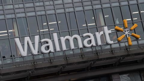 """The Walmart logo is seen on a store in Washington, DC, on March 1, 2019. - Walmart is in damage-control mode over a plan to phase out store greeters, a shift that closes off an employment niche that had frequently been taken by disabled workers. The retail giant, the biggest employer in the United States, has revamped the position of """"People Greeter"""" into """"Customer Host"""" and added new tasks, such as handling customer refunds, scanning receipts and checking shopping carts. (Photo by NICHOLAS KAMM / AFP)        (Photo credit should read NICHOLAS KAMM/AFP/Getty Images)"""