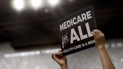 A member of the audience holds up a placard as US Senator Bernie Sanders, Independent from Vermont, discusses Medicare for All legislation on Capitol Hill in Washington, DC, on September 13, 2017.