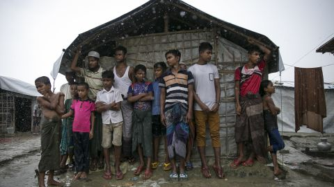 COX'S BAZAR, BANGLADESH - AUGUST 21: Rohingya are seen during a rainstorm at the Nayapara refugee camp on August 21, 2019 in Cox's Bazar, Bangladesh. Rohingya refugees said on August 21st that they did not want to return to Myanmar without their rights and citizenship, with repatriation set to start on August 22nd. August 25th marks the second anniversary of the Rohingya crisis in Bangladesh after Myanmar's military crackdown on the ethnic Muslim minority forced over 700,000 to flee to Bangladesh from violence and torture. The United Nations has stated that it is a textbook example of ethnic cleansing. (Photo by Allison Joyce/Getty Images)