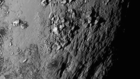 IN SPACE - JULY 14:  In this handout provided by the National Aeronautics and Space Administration (NASA), a close-up image of a region near  Pluto's equator shows a range of mountains rising as high as 11,000 feet (3,500 meters) taken by NASA's New Horizons spacecraft as it passed within 7,800 feet of the dwarf planet on July 14, 2015. The 1,050-pound piano sized probe, which was launched January 19, 2006 aboard an Atlas V rocket from Cape Canaveral, Florida, zipped by the planet yesterday.  (Photo by NASA/APL/SwRI via Getty Images)