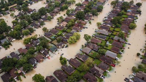 This aerial photo shows flooded residential neighborhoods in Houston.