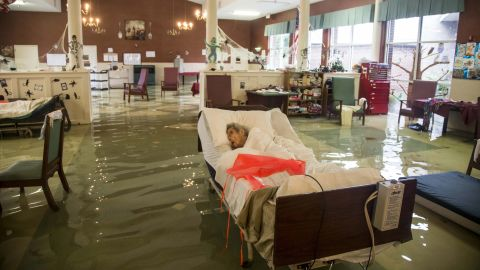 An elderly patient waits to be rescued from the Gulf Health Care Center in Port Arthur. The facility was evacuated with the help of first responders and volunteers.