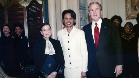Ginsburg stands with President George W. Bush and Secretary of State Condoleezza Rice at the Department of State in January 2005. Ginsburg had sworn in Rice that day.