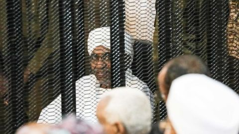 Sudan's ousted President Omar al-Bashir is seen inside the defendant's cage during his corruption trial in Khartoum on Saturday.