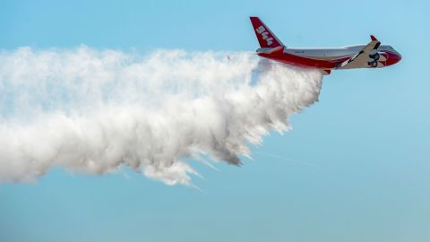FILE - In this May 5, 2016, file photo, the Boeing 747-400 Global SuperTanker drops half a load of it's 19,400-gallon capacity during a ceremony at the Colorado Springs, Colo., Airport demonstrating the firefighting capabilities of the world's largest firefighting plane. Scott McLean, deputy chief of California's Department of Forestry and Fire Protection said Saturday, July 7, 2018, the supertanker is undergoing final checks at McClellan Air Base outside Sacramento. Once cleared by the state and the U.S. Forest Service, the plane can be sent to fires anywhere in the state. (Christian Murdock/The Gazette via AP, File)