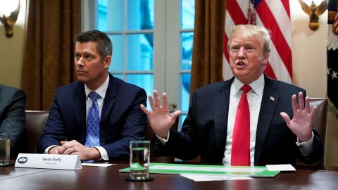 In this January 24, 2019 file photo, US President Donald Trump, with US Congressman Sean Duffy (L), are seen in the Cabinet Room of the White House. Trump spoke about the unfair trade practices at play in the world.