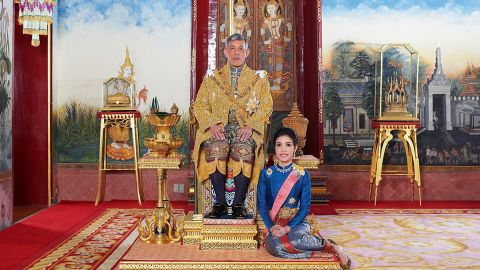 """This undated handout from Thailand's Royal Office received on August 26, 2019 shows Thailand's King Maha Vajiralongkorn posing with royal noble consort Sineenat Bilaskalayani, also known as Sineenat Wongvajirapakdi. - Thailand's palace has released rare images and a biography of the king's newly-annointed royal consort, including action-packed photos of her aiming a weapon on a firing range, piloting a plane, and preparing to parachute. (Photo by Handout / THAILAND'S ROYAL OFFICE / AFP) / -----EDITORS NOTE --- RESTRICTED TO EDITORIAL USE - MANDATORY CREDIT """"AFP PHOTO / THAILAND'S ROYAL OFFICE """" - NO MARKETING - NO ADVERTISING CAMPAIGNS - DISTRIBUTED AS A SERVICE TO CLIENTSHANDOUT/AFP/Getty Images"""