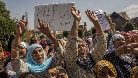 Kashmiri Muslim women shout anti Indian slogans during an anti Indian protest, on August 23, 2019 in Srinagar.