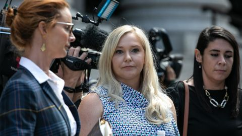 VirginiaGiuffre, an alleged victim of Jeffrey Epstein, center, exits from federal court in New York, US, on Tuesday, Aug. 27, 2019.