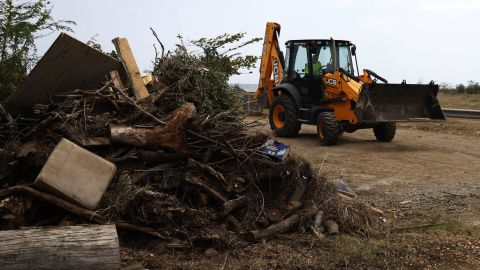 Municipal employees clear debris in Ponce, Puerto Rico, on August 27.