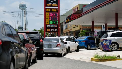 Cars line up for fuel at a gas station in Mayaguez, Puerto Rico, on Tuesday, August 27.
