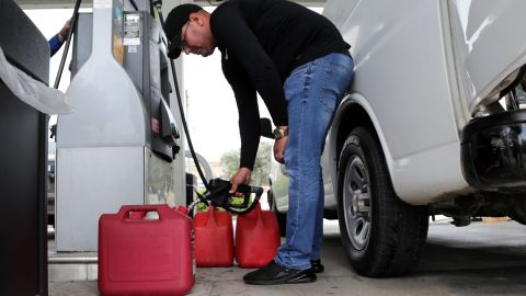 A man fills containers with gasoline in Hialeah, Florida, on August 29.