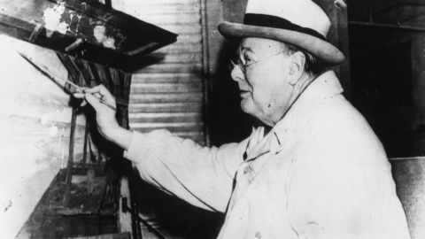 Winston Churchill works on a canvas in a cabana at the Miami Beach Surf Club, Florida in 1946.
