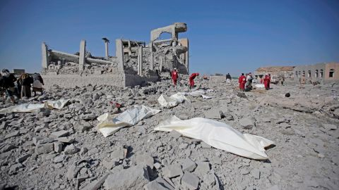 Bodies lie on the ground after being recovered from under the rubble of a Houthi detention center destroyed by Saudi-led airstrikes.