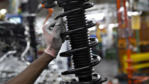 An employee places a suspension vehicle component on a hanging conveyor at the Ford Motor Co. Chicago Assembly Plant in Chicago, Illinois, U.S., on Monday, June 24, 2019. Ford invested $1 billion in Chicago Assembly and Stamping plants and added 500 jobs to expand capacity for the production of all-new Ford Explorer, Explorer Hybrid, Police Interceptor Utility and Lincoln Aviator. Photographer: Daniel Acker/Bloomberg via Getty Images