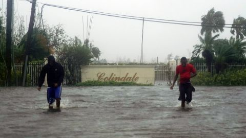 Residents wade through a flooded street in Freeport on September 3.