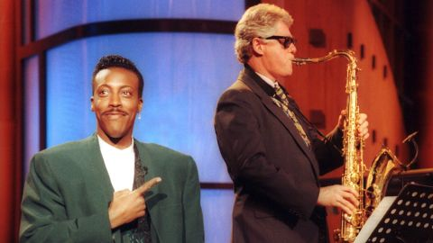"""Talk show host Arsenio Hall gestures approvingly as Clinton plays the saxophone during a taping of """"The Arsenio Hall Show"""" in 1992. Clinton was running for president at the time."""