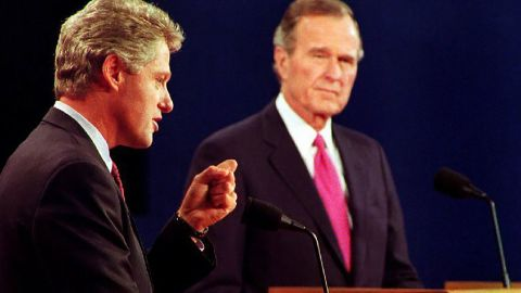Clinton debates President George H.W. Bush and independent candidate H. Ross Perot, not pictured, in October 1992. It was their third and final debate.