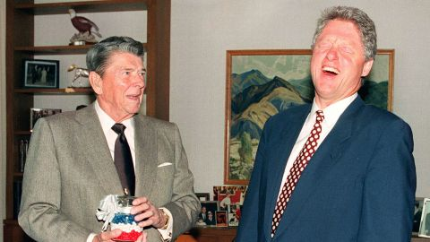 Former President Ronald Reagan presents Clinton with a jar of red, white and blue jelly beans in Los Angeles in November 1992. Reagan said they kept him from smoking cigarettes.