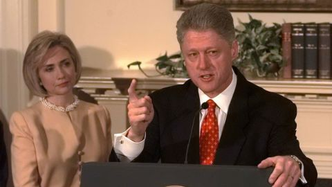 """Clinton speaks about the Monica Lewinsky scandal at the White House in January 1998, as first lady Hillary Clinton looks on. """"I did not have sexual relations with that woman,"""" he said."""