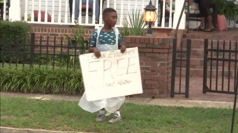Jermaine Bell  advertises free food and water for Hurricane Dorian evacuees.